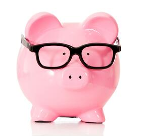 Geeky piggybank with glasses - isolated over a white background.jpeg
