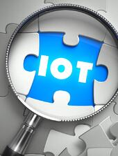IOT - Word on the Place of Missing Puzzle Piece through Magnifier. Selective Focus..jpeg